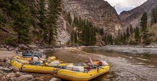 A row of rafts, beached for the night at a camp on the Middle Fork of the Salmon River, Idaho